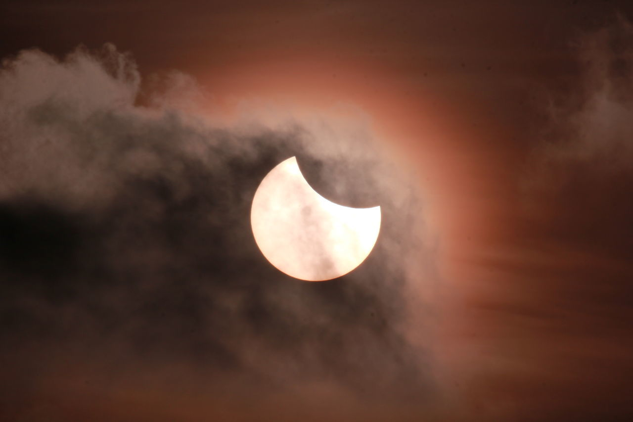 Partial Solar eclipse Astronomy Beauty In Nature Cloud Cloud - Sky Cloudy Dusk Idyllic Low Angle View Majestic Moon Nature Night No People Outdoors Scenics Sky Sky Only Sunset Tranquil Scene Tranquility