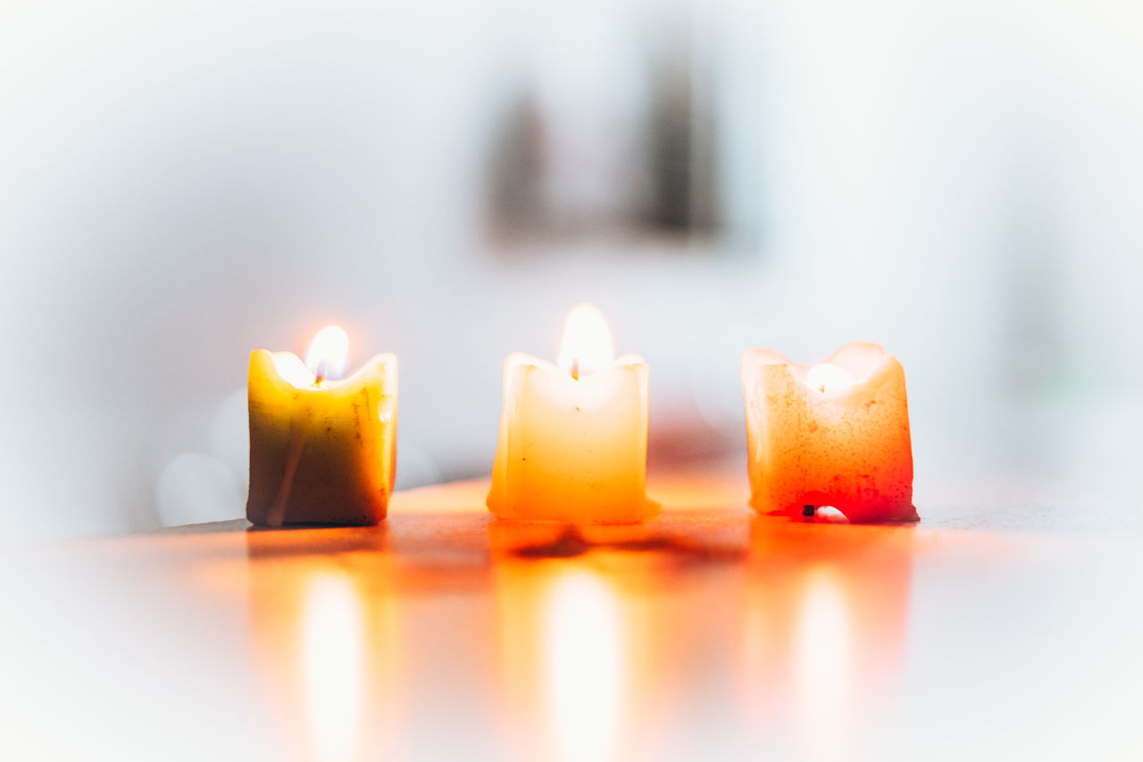 Ambiance Peaceful Burning Candle Celebration Clean Clear Mind Close-up Day Flame Focus On Foreground Glow Heat - Temperature Illuminated Indoors  Life Light Melting No People Prayer Reflection Soft Table Three Candles White