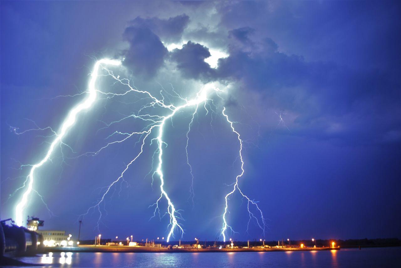 Illuminated Night Water Lightning Power In Nature Thunderstorm Scenics Weather Harbor Sky Thunderstorms Lightning Strikes Extreme Weather Shelf EiderstedtDramatic Sky Sea Electricity  Storm Storm Cloud Nature Beauty In Nature Overnight Success Blue Cloud - Sky