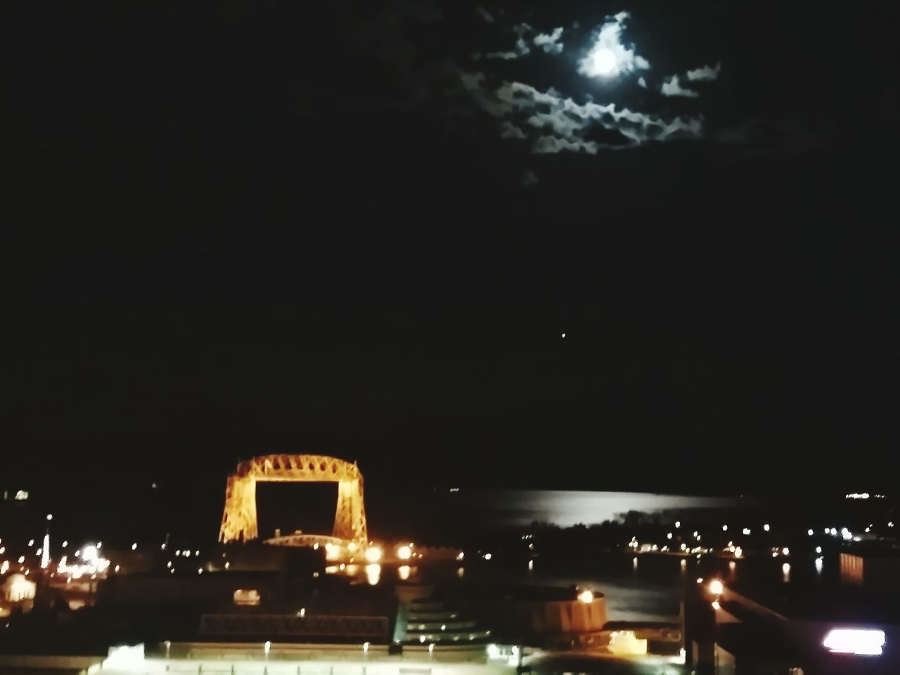 night, illuminated, architecture, built structure, sky, building exterior, outdoors, low angle view, moon, no people, city, nature, water