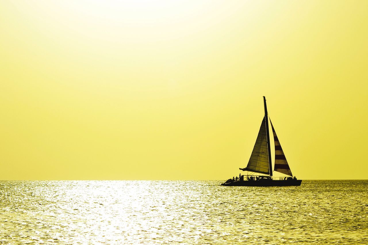 Sea Water Nautical Vessel Sunset Sailing Yellow Nature Clear Sky Horizon Over Water Sailboat Idyllic Beauty In Nature Outdoors No People Scenics Sky Day Yachting EyeEm Best Edits EyeEmNewHere EyeEm Best Shots EyeEm Nature Lover Boat Boats Beauty In Nature EyeEmNewHere
