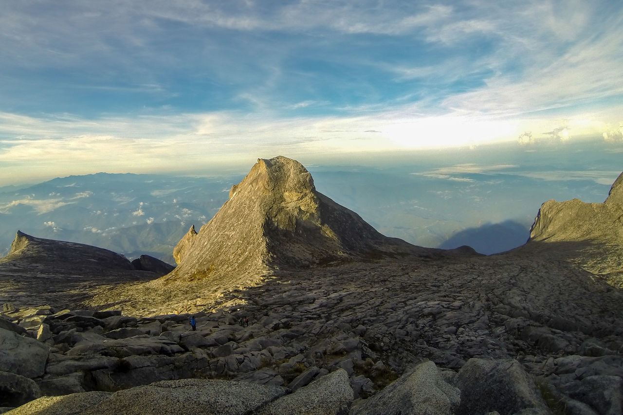 View from Low's Peak of mountain Kinabalu,Sabah,with background of St John Peak.Its the highest mountain in Malaysia is one of Borneo's most popular tourist attractions. Adventure Akinabalu Amazing View Borneo Climber Climbing A Mountain Hiking Laban Rata Low Peak Mountain Mountain Kinabalu Mountains And Sky Mt Kinabalu Ranau Trail Sabah Sabah Borneo St John Mountain Kinabalu Timpohon Trail Top Of The Mountain Top Of The Mountains Top Of The Rock