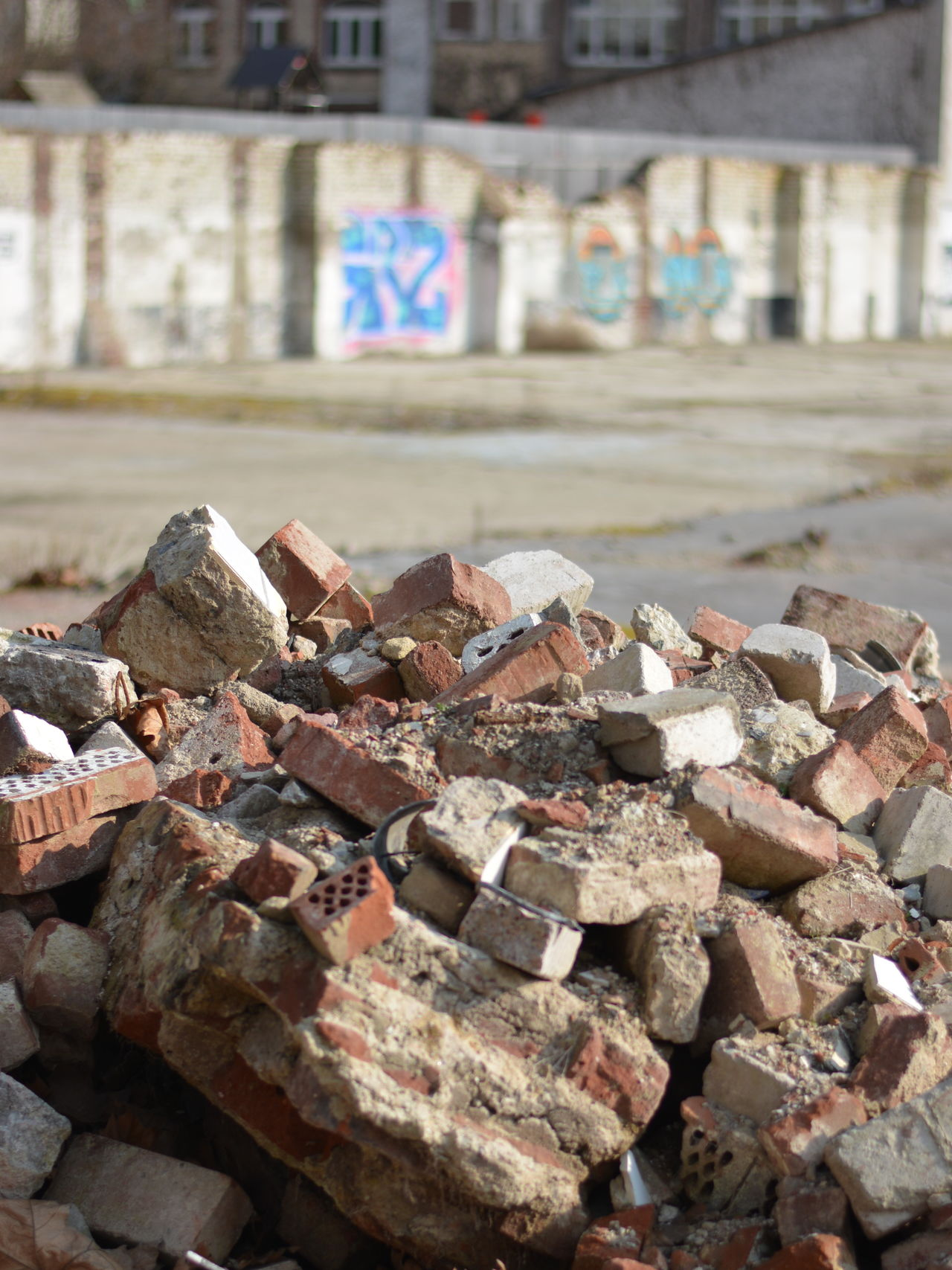 To build up you first have to tear down. Or? Bricks Bricks And Stones Deserted Spaces Deterioration Focus On Foreground Heap Large Group Of Objects No People Open Space Outdoors Parking Lot Rubble Street Art North Rhine-westphalia Nordrhein-Westfalen Duesseldorf Germany