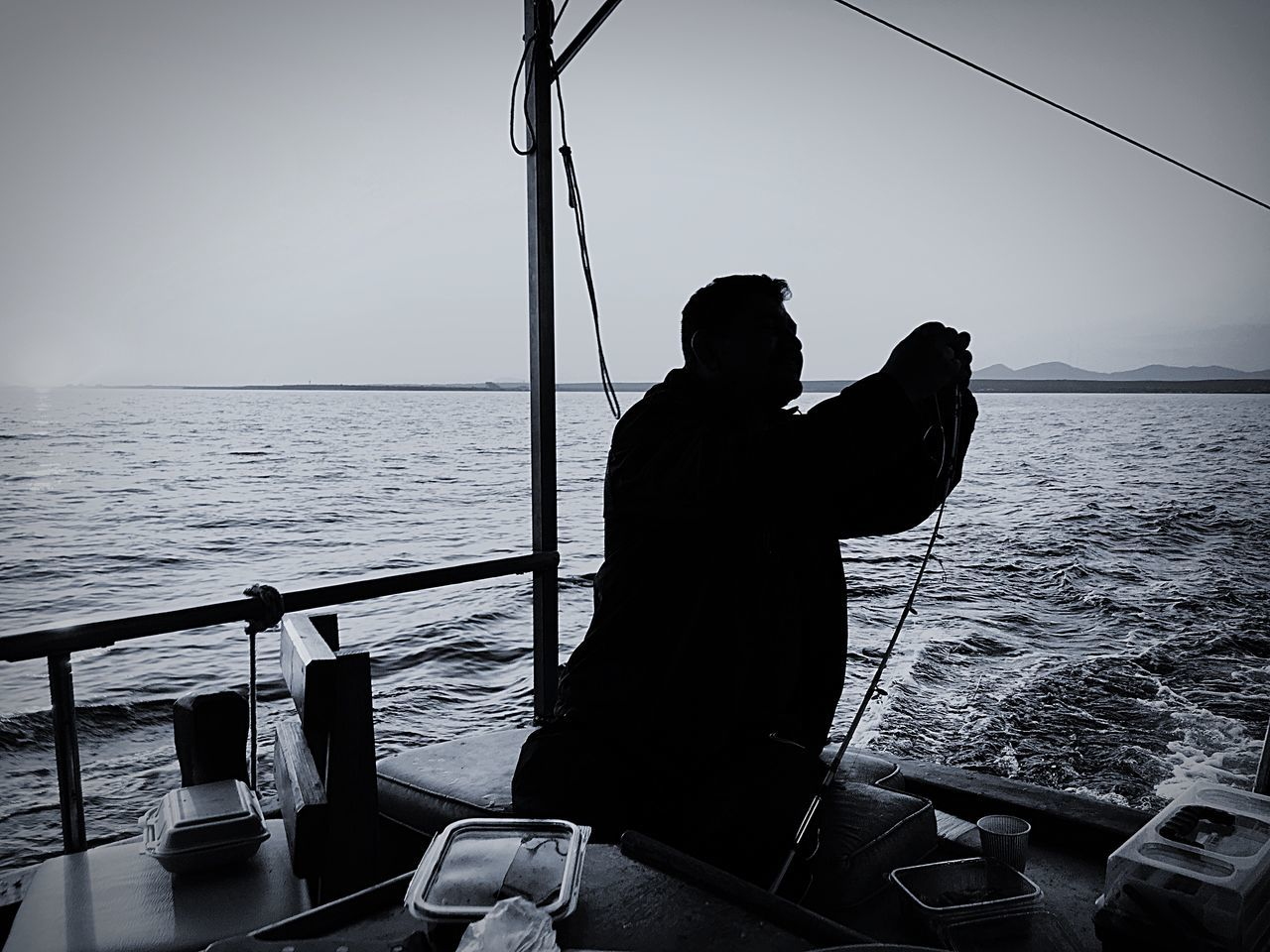 Sailing Yacht Sea Fishing One Person Real People Nature Outdoors Fisherman Clear Sky Beauty In Nature EyeEm EyeEm Best Edits EyeEm Gallery EyeEm Best Shots Sea And Sky Blackandwhite Blackandwhite Photography Shadow Silhouette Hello World Eye4photography  Check This Out Travelling The Secret Spaces EyeEm Diversity