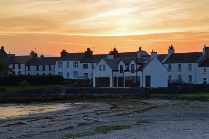 Taken on a work trip to Islay Architecture EyEmNewHere Nikon Orange Orange Sky Sunset_collection Whisky Work Travel Beach Beauty In Nature Building Building Exterior Buildings Built Structure Eyem Eyem Gallery Eyemphotography Famous For Whisky Islay Islaywhisky Loganair Love To Travel Sunset Water White