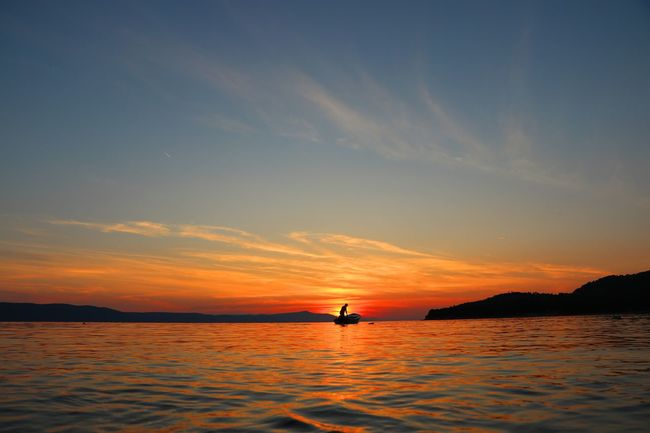 Sunset Sea Sun Reflection Sky Landscape Beach Tourism Scenics Outdoors Nautical Vessel Nature Travel Destinations One Person Water Horizon Over Water Silhouette Beauty In Nature Beauty Floating On Water