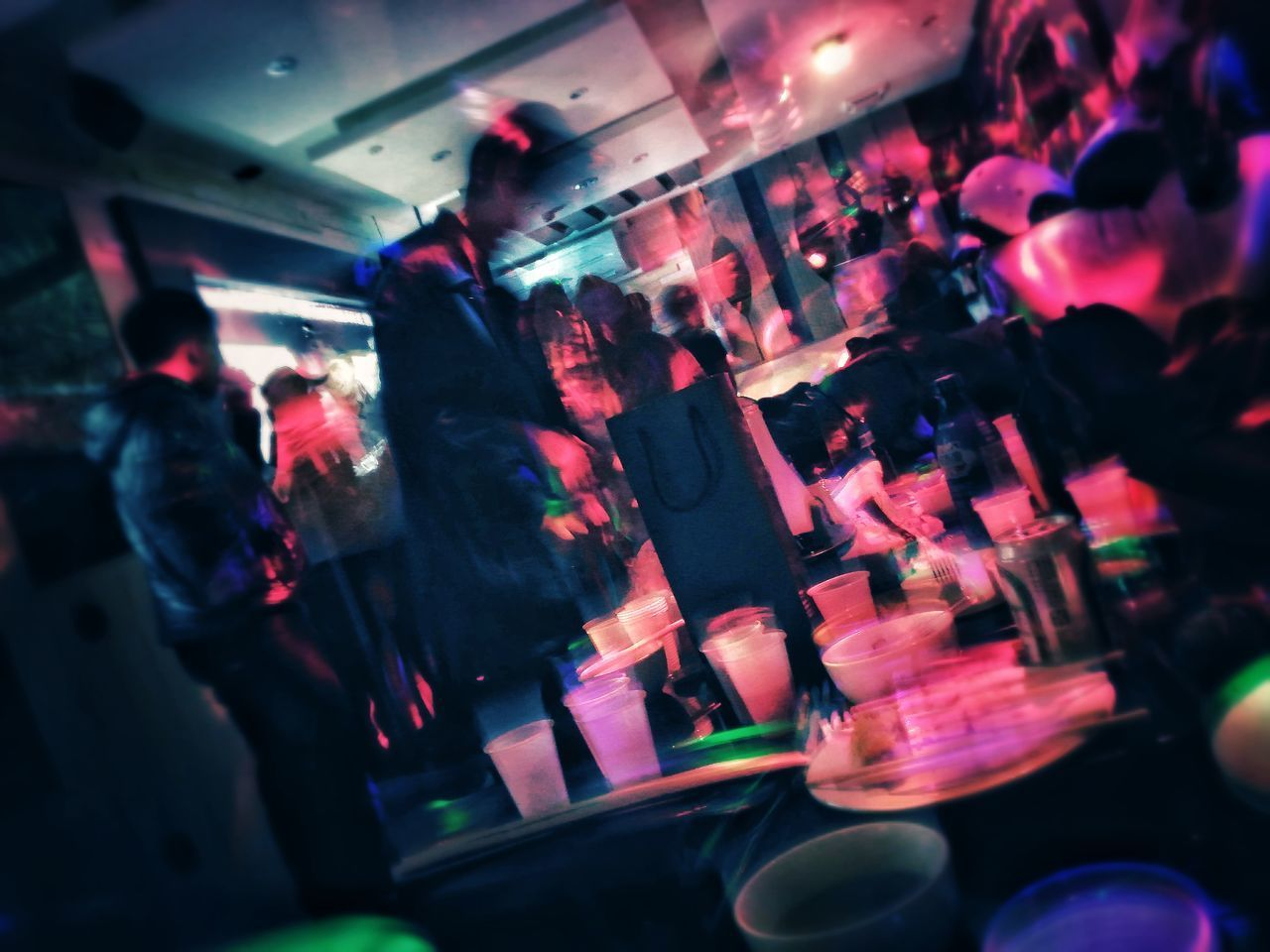 indoors, retail, night, real people, large group of objects, multi colored, illuminated, close-up