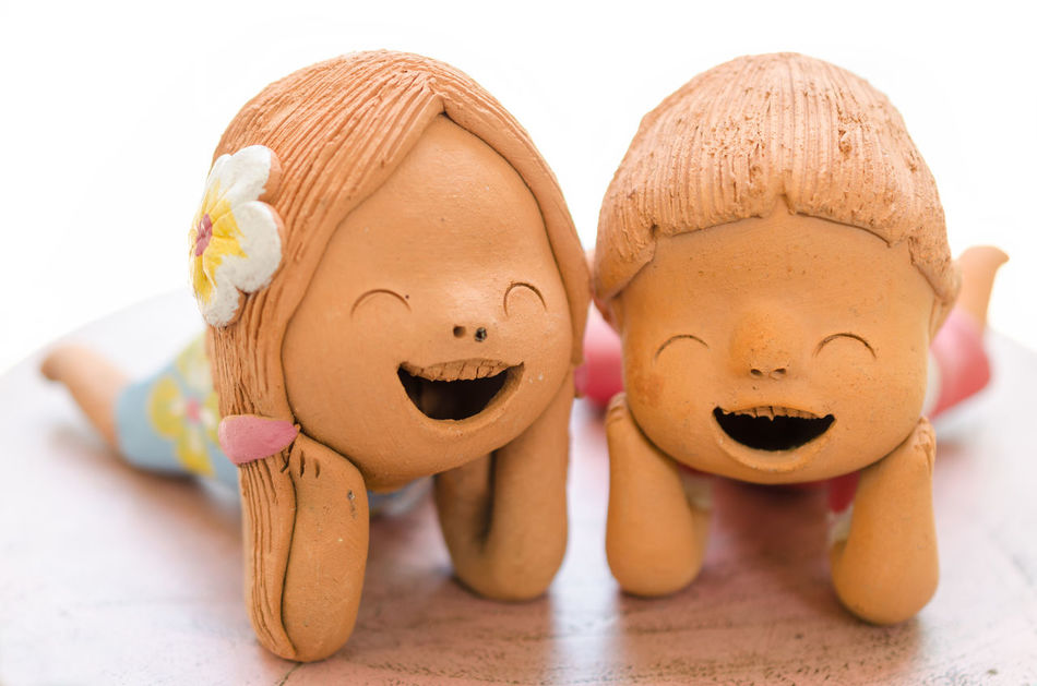 2 Smiling boy and girl clay dolls, Happiness concept. Art Clay Doll Close-up Decoration Figurine  Handmade Happiness No People Play Sculpture Smiling Statue Thailand Toy White Background
