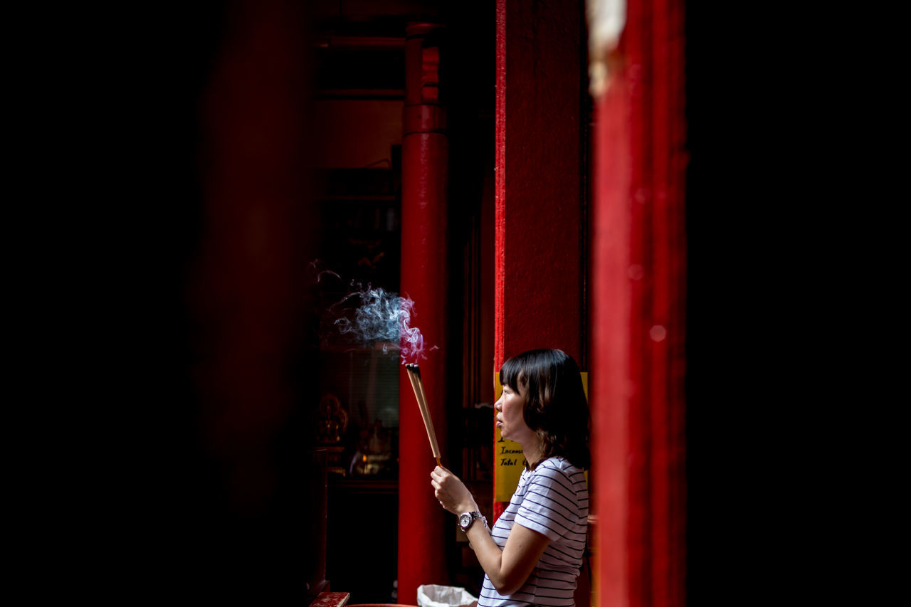 Chinese Woman praying with incense stick Altar EyeEm Best Shots Faith Kuala Lumpur Lantern Red Smoke Taoist Tourist Tourist Attraction  Travel Adult Adults Only Belief Casual Clothing Chinese Day Eyeem People Holding Incense Incense Sticks Indoors  Jostick Malaysia One Person People Praying Real People Red Religion Side View Street Photography Taoim Temple Travel Destinations Young Adult Young Women