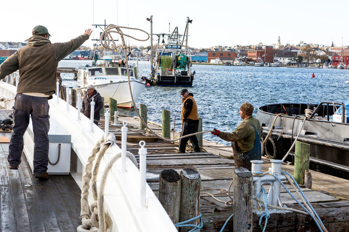 Rope Tall Ship Adult Boat Launch Boat Maintenance Day Fisherman Marine Railway Men Nautical Vessel Occupation Outdoors People Real People Schooner Sky Teamwork Transportation Water Working
