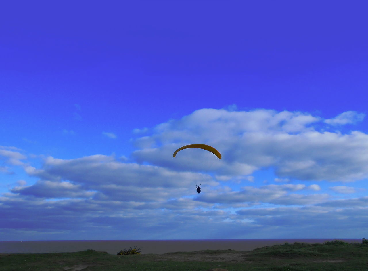parachute, adventure, extreme sports, sky, real people, paragliding, nature, leisure activity, cloud - sky, one person, blue, day, outdoors, mid-air, beauty in nature, lifestyles, scenics, sport, people