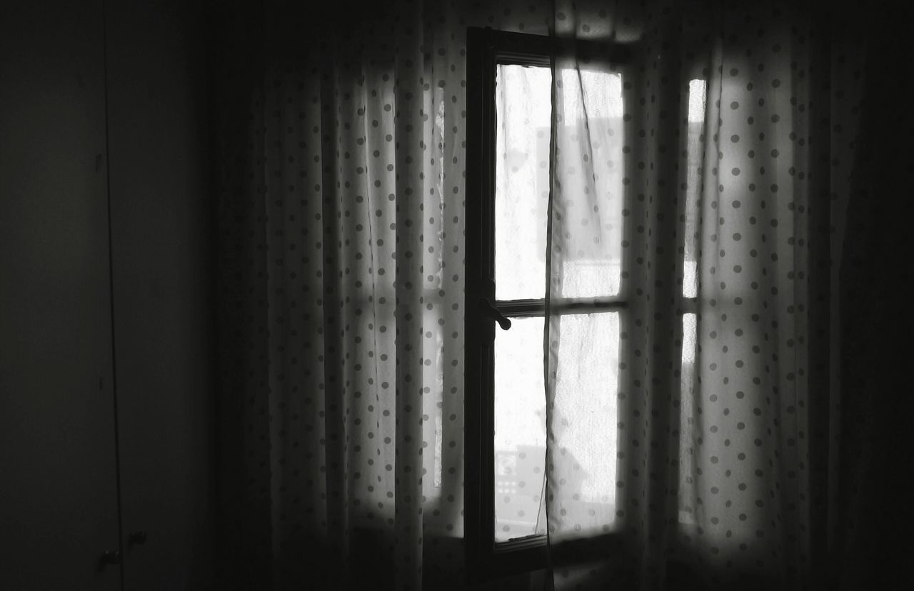 Windows Covered With Curtains At Home