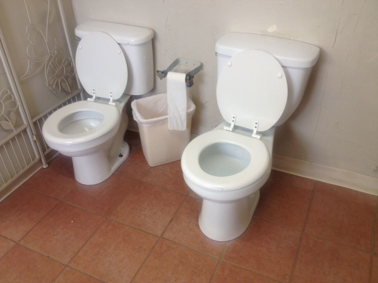 bathroom, toilet bowl, toilet, flushing toilet, indoors, domestic bathroom, convenience, white color, public building, hygiene, public restroom, high angle view, urinal, no people, urgency, bidet, day