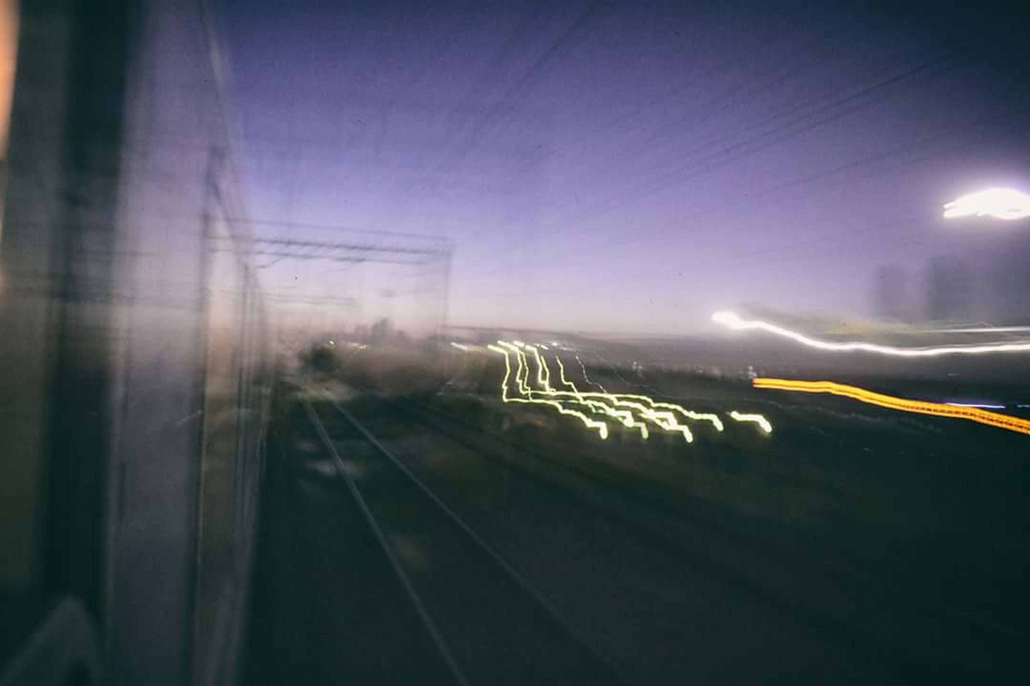 illuminated, night, blurred motion, lens flare, light trail, defocused, light beam, glowing, light, sky