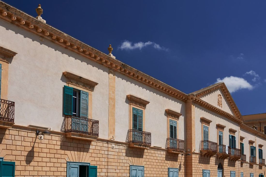 Noto, Sicily Travel Destinations Palace Palazzo No People Landmark Architecture Historic Historical Building Italy Noto Sicily Blue Sky UNESCO World Heritage Site Building Exterior Façade Cloud - Sky Built Structure Lines And Shapes