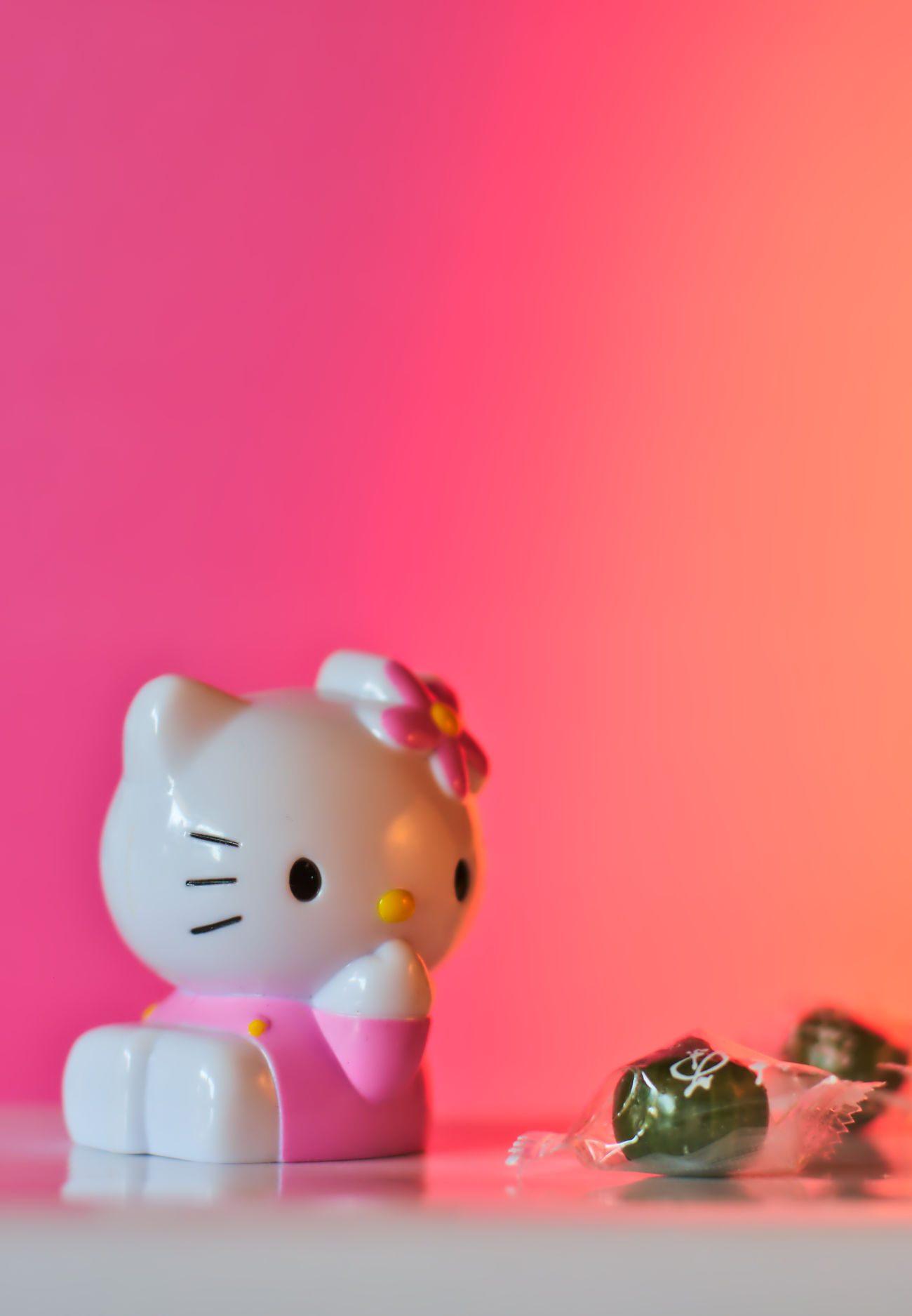 Sweet Hello Kitty Candy Close-up Color Of Life Fantasy Figure Figurine  Focus On Foreground Girly Hello Kitty Japan Light And Shadow Matcha Millennial Pink Nikon Pink Pink Background Pink Color Still Life Photography Studio Shot Sweet Temptation Toy Toy Adventures ハローキティ 抹茶 日本