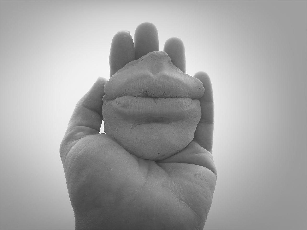 Beautiful stock photos of lips, Close-Up, Holding, Human Body Part, Human Hand