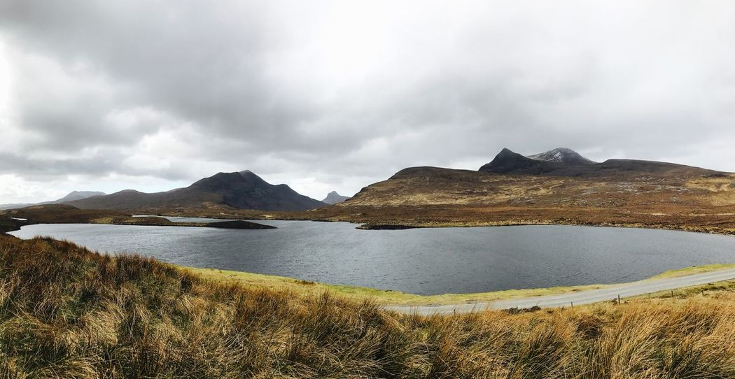 Panorama Wide Shot Beauty In Nature Scenics Nature Mountain Grass Outdoors Sky Tranquility Day No People Tranquil Scene Water Cloud - Sky Landscape IPhone Contrast Scotland Tranquility Vivid Highlands