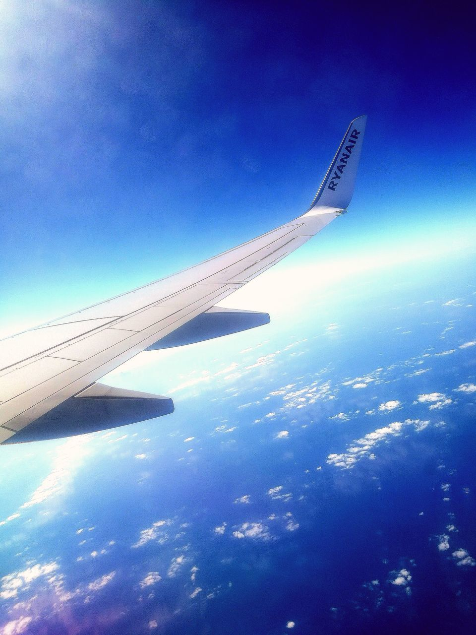 blue, airplane, aerial view, transportation, airplane wing, journey, sky, nature, no people, day, travel, outdoors, air vehicle, beauty in nature, scenics, flying