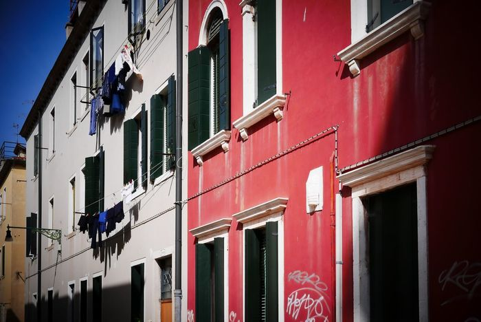 Laundry shadows Building Exterior Window Architecture Built Structure Day Outdoors Residential Building No People Low Angle View Wooden Shutters Light Travel Photography Laundry Laundry Hanging Red Building Red Lookingup Rome Italy Shadows & Lights Shadows Whatisee EyeEm Best Shots EyeEmNewHere Eye4photography