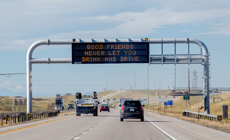 am interesting public service sign on wyoming highways in the usa. Industrial Metal Large Outdoors Technology Communication Signboard Signage Man Made Structure Information Big Brother Information Sign Common Sense Highways&Freeways Wyoming USA Vehicles On Road Drinking And Driving