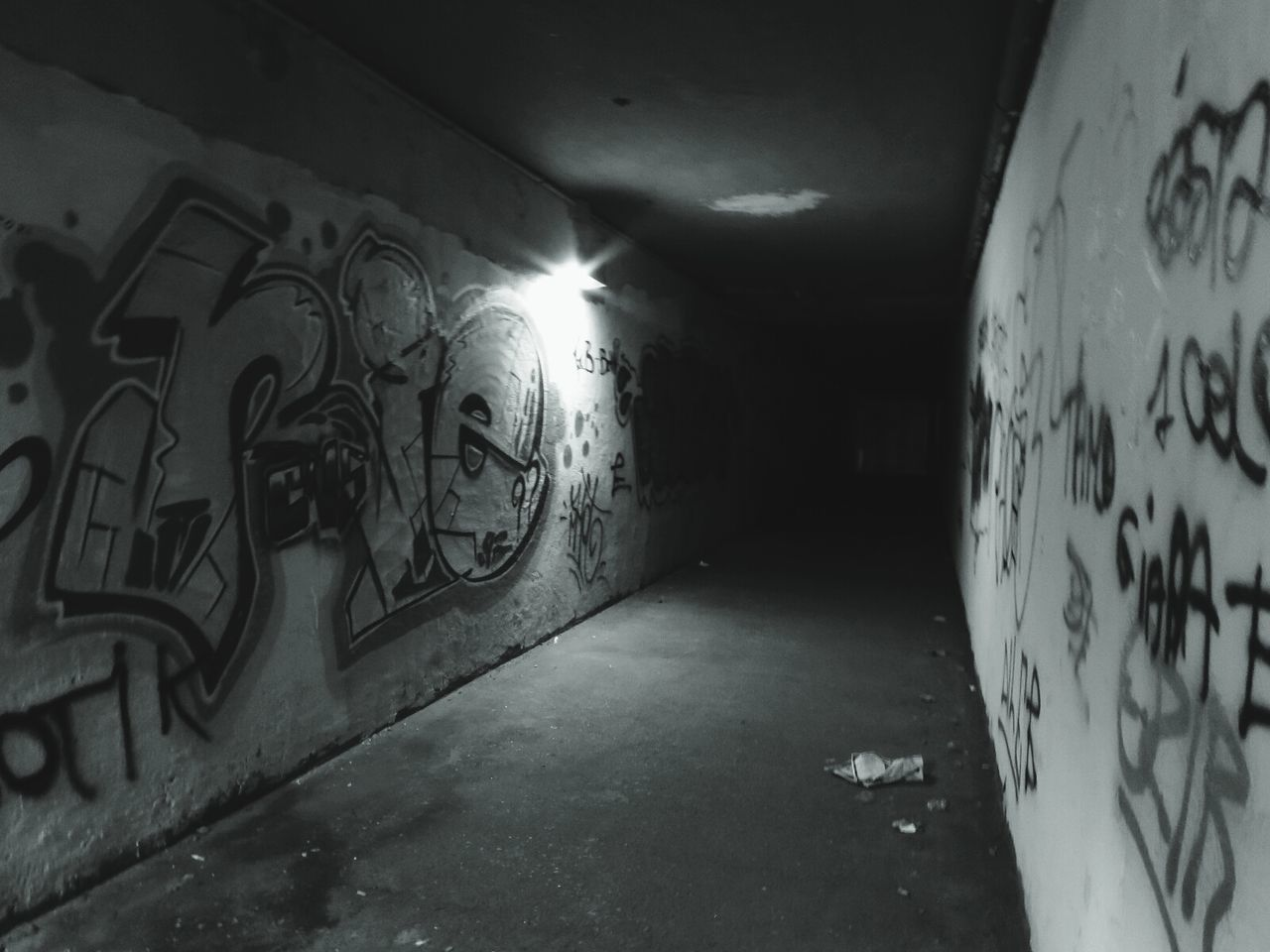 graffiti, indoors, illuminated, architecture, tunnel, built structure, no people, basement, day