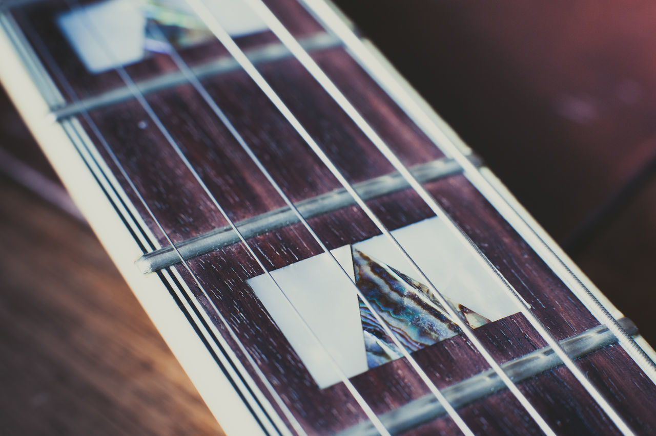 music, musical instrument, guitar, musical instrument string, arts culture and entertainment, fretboard, string instrument, woodwind instrument, close-up, indoors, no people, classical guitar, classical music, day