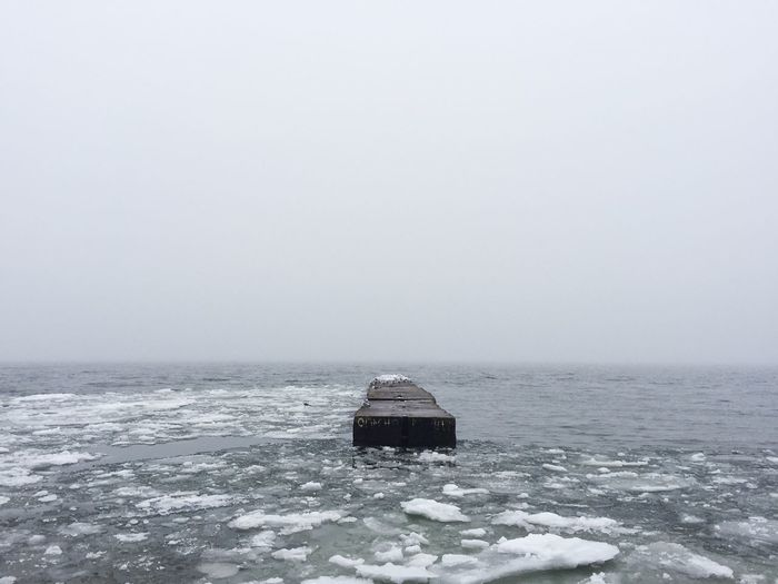 Partly frozen winter sea in Mariupol Beautiful Bech Calm Cold Cold Temperature Frozen Frozen Sea Global Warming Grey Day Horizon Over Water Ice Inspiration Mariupol Meditation Nature No People Peace Pier Remote Sea Tranquility Tranquility Travel Ukraine Winter