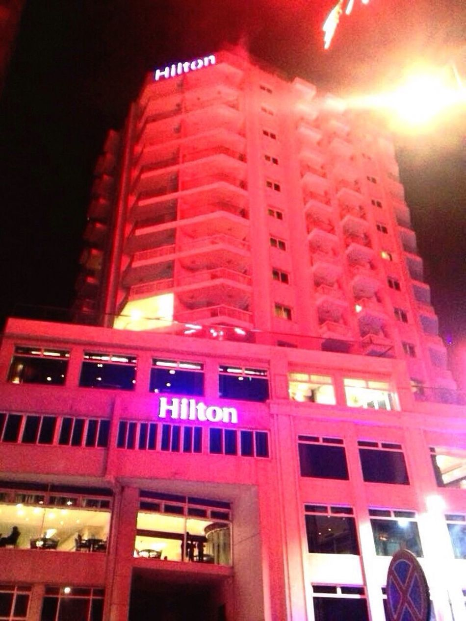 Hiltonhotel Architecture Night Low Angle View Red Illuminated Built Structure Building Exterior No People City Outdoors Red Light
