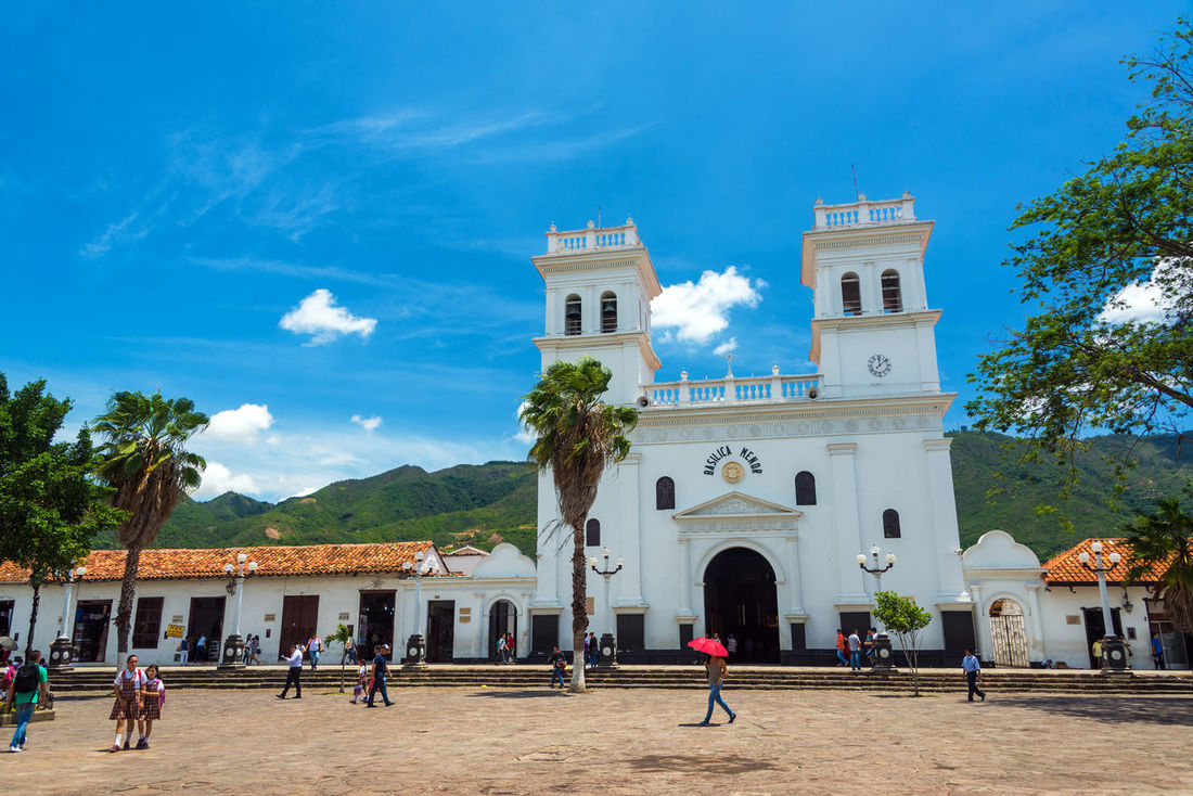 GIRON, COLOMBIA - MAY 3: View of the basilica and main plaza in Giron, Colombia on May 3, 2016 Basilica Cathedral Church City Cloud Colombia Exterior Mainplaza Santander Travel View Architecture Bucaramanga Building Building Exterior Built Structure Clouds Colonial Corner Girón Old Outdoors People Plaza Street