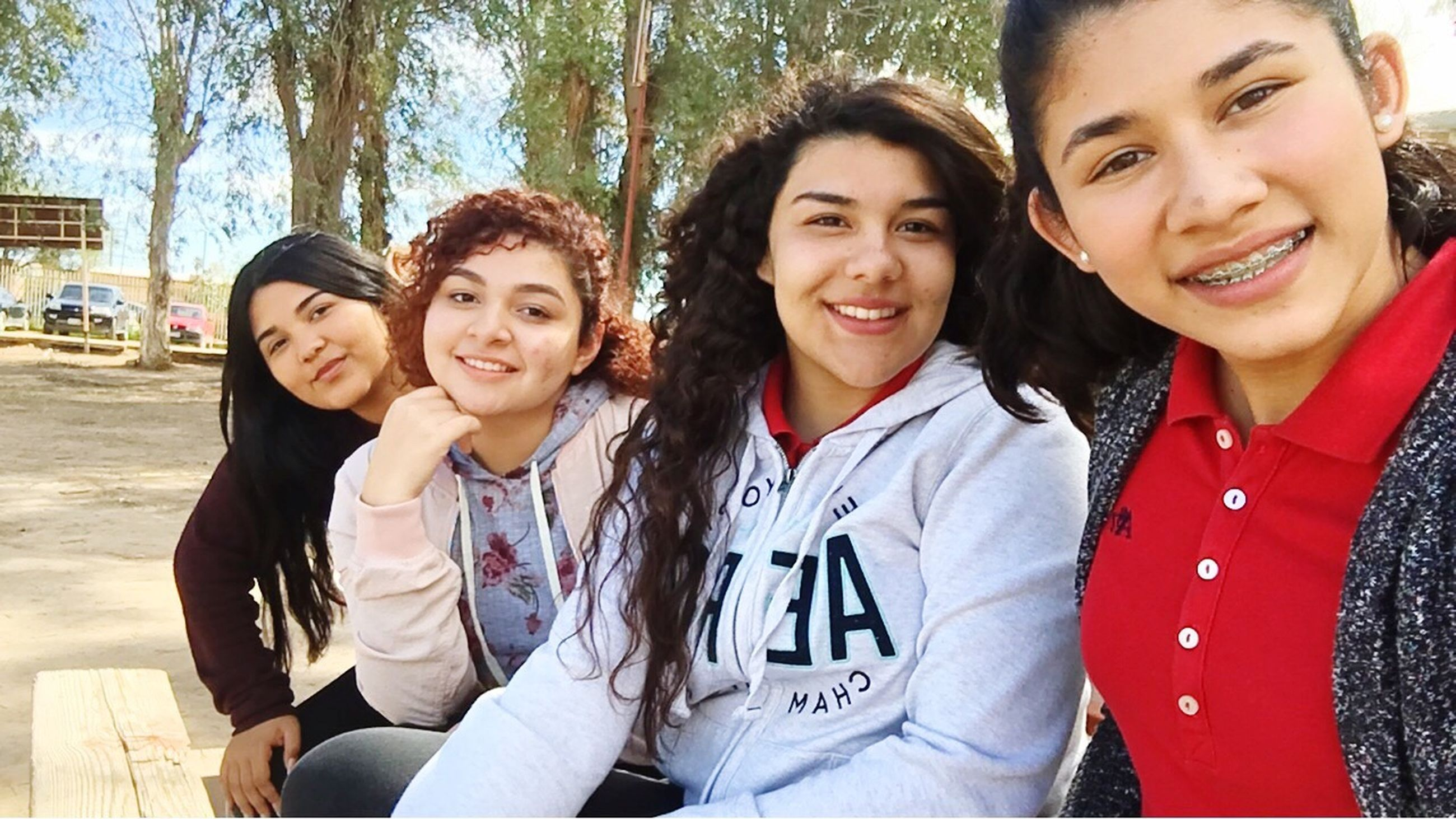 portrait, looking at camera, smiling, teenager, young adult, friendship, togetherness, beauty, beautiful people, people, cheerful, outdoors, happiness, archival, women, selfie, young women, student, adult, tree, day, adults only