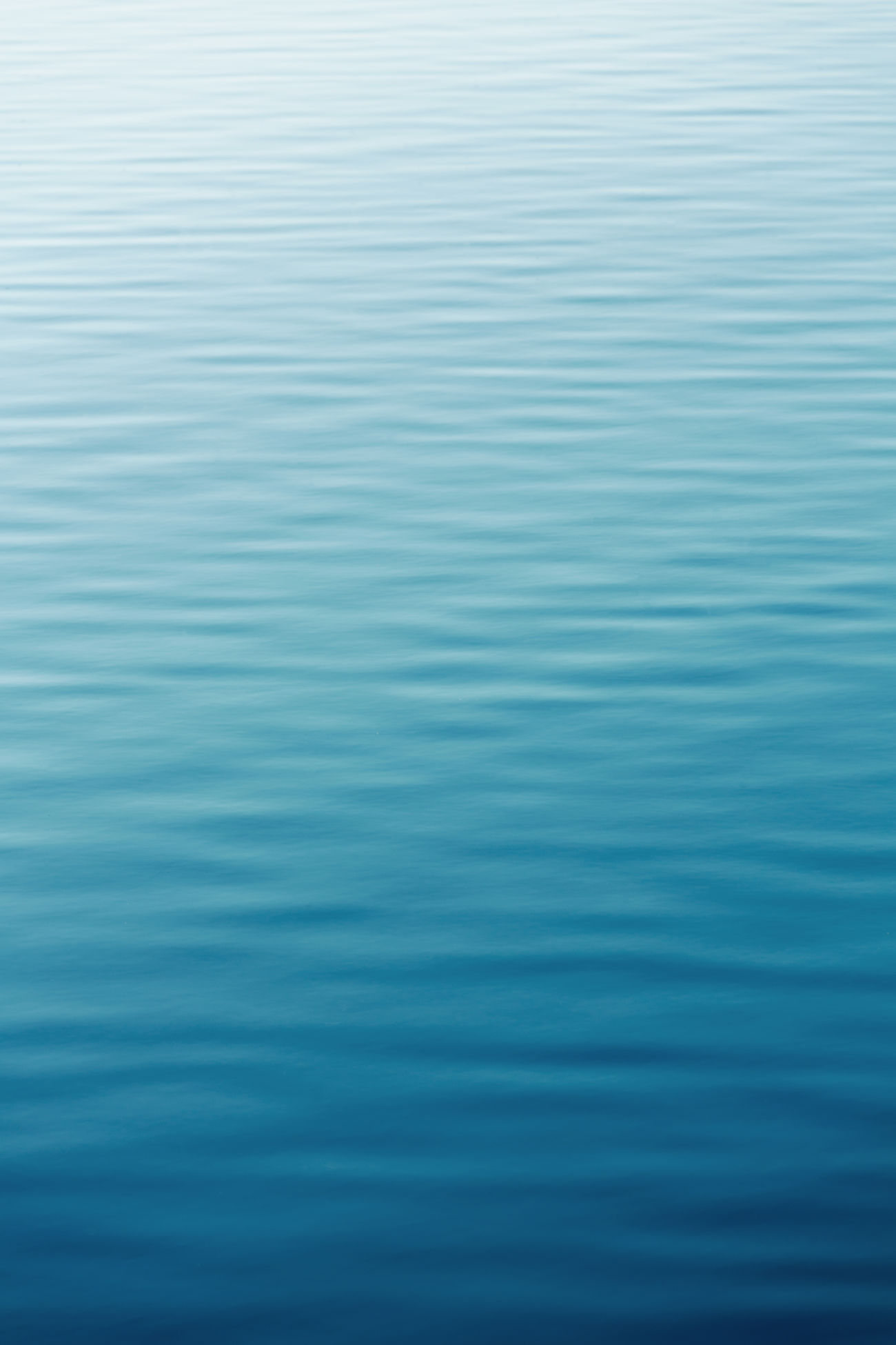Silent surface of blue water Reflection Sea Backgrounds Beauty In Nature Blue Colorful Day Lake Nature Nature No People Outdoors Reflection Rippled Rippled Water Sea Sea View Silence Silence Of Nature Silent Moment Textured  Water Water Waves