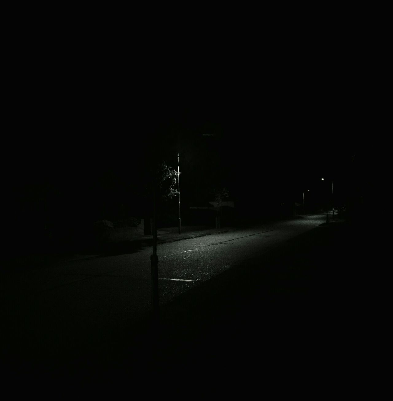 New street lights turn everywhere into nowhere. Drama Dramatic Black And White Photography Blackandwhite Black And White Night Streets At Night Eerie Eerie Scene Eerie Night Cities At Night Lonliness Voids Nowhere Empty Places