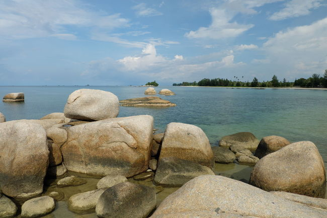 Beach Beauty In Nature Cloud - Sky Day Nature Non-urban Scene Outdoors Rock Rock - Object Scenics Sea Shore Sky Stone Stone - Object Summer Tourism Tourist Tranquil Scene Tranquility Travel Destinations Vacations Water Weekend Activities