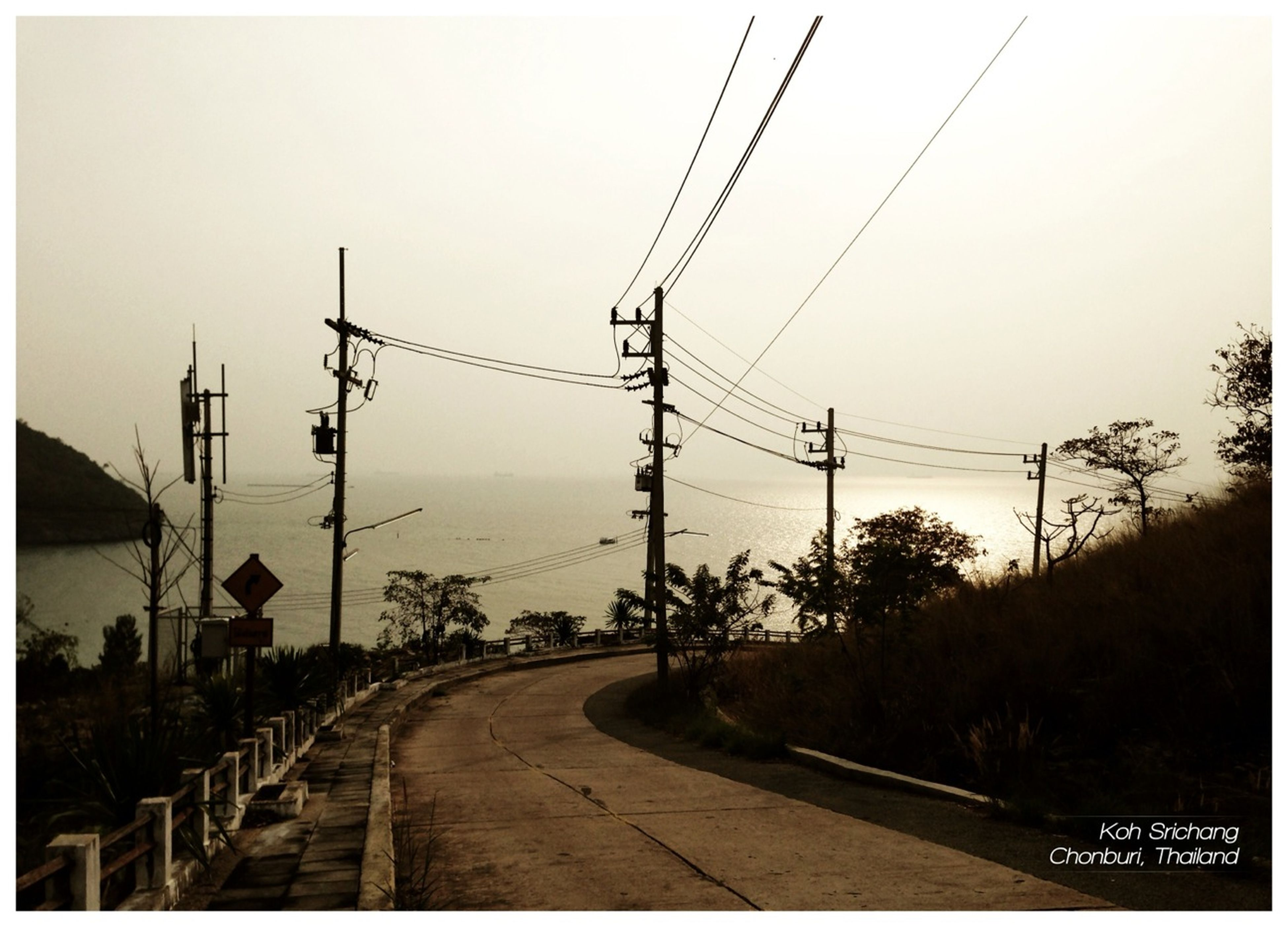 power line, electricity pylon, transfer print, transportation, electricity, power supply, the way forward, clear sky, connection, cable, road, auto post production filter, sky, fuel and power generation, diminishing perspective, power cable, street light, street, railroad track, tree