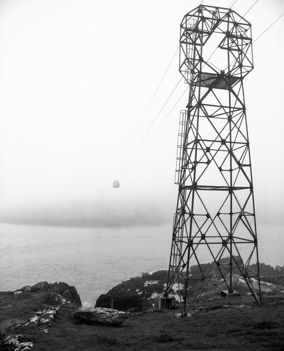 View of Dursey Island. Only about five people live on Ireland's most south-western rocky island, connected to the main land only by a fragile cable car. 120 Atlantic Ocean Black And White Cable Car Dursey Island Horizon Over Water Idyllic Ilford Delta 100 Ireland Landscape Mamiya RB67 No People Outdoors Remote Remote Islands The Great Outdoors - 2016 EyeEm Awards Tranquil Scene Becherschool Fine Art Photography