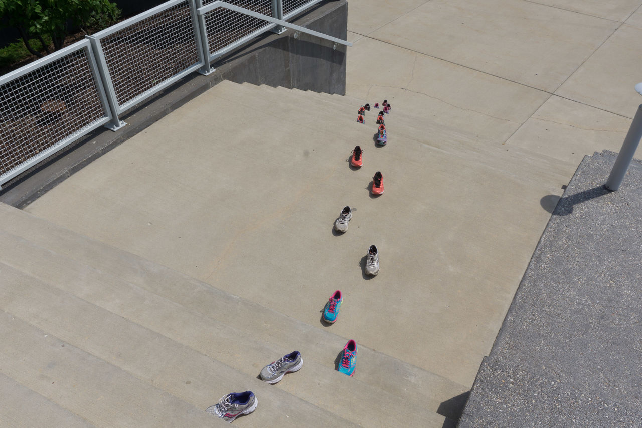 Shoes thru time up the stairs Architecture Built Structure Colorful Day From Above  High Angle View Leisure Activity Many Pairs Out Of The Box Outdoors Outside Playing Railings Stairs Steps And Staircase Sunny Day Sunny☀ Woman,s Athletic Shoes