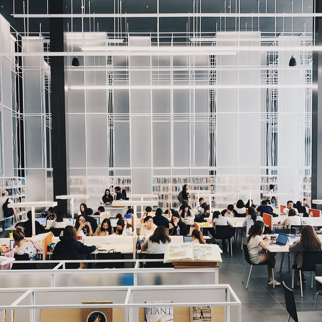 Occupation Large Group Of People Sitting Crowd Indoors  Business Modern Architecture People Working Coworker Indoors  Office Built Structure Architecture Book Shelf Bookshelf Library