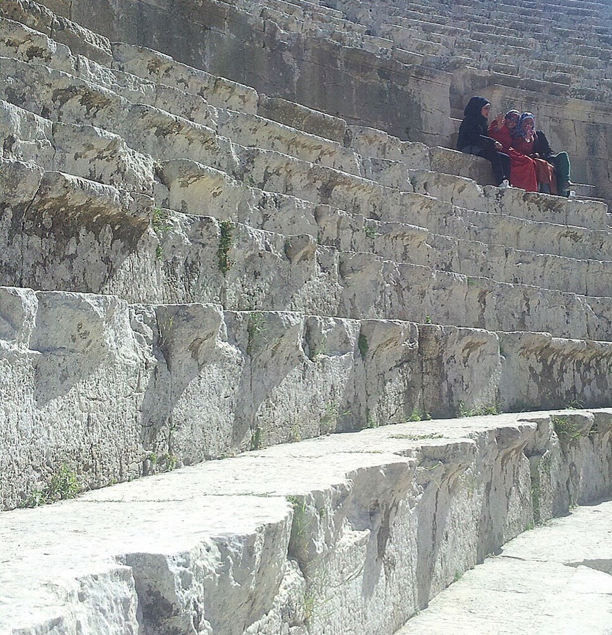 real people, men, built structure, steps and staircases, two people, steps, architecture, lifestyles, women, leisure activity, day, outdoors, standing, sitting, full length, togetherness, climbing, adult, photography themes, nature, ancient civilization, people, adults only