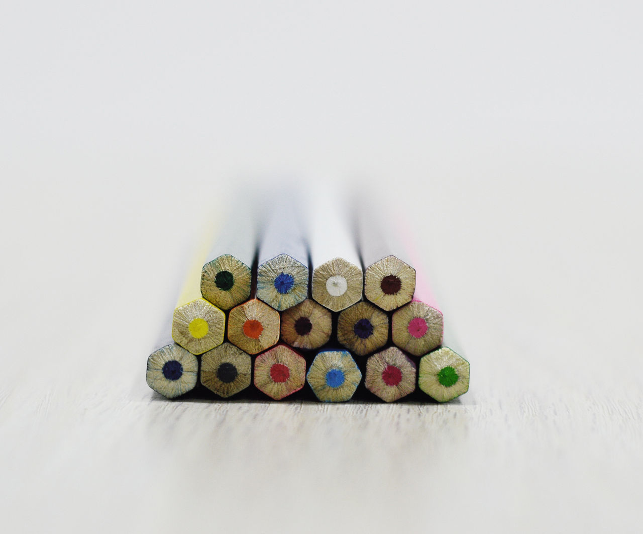 Close-Up Of Colorful Pencils Against White Background