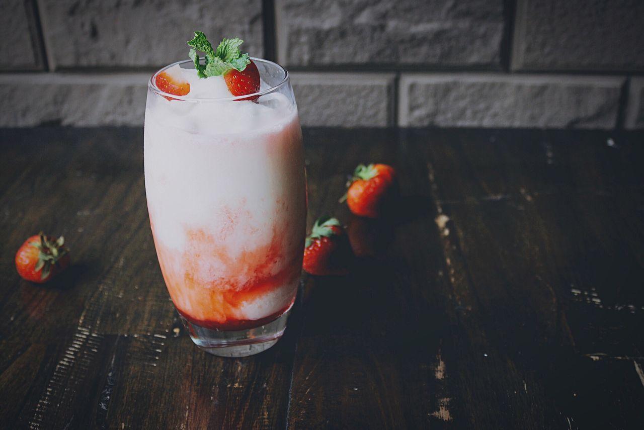 Close-Up Of Fresh Strawberry Milkshake On Table
