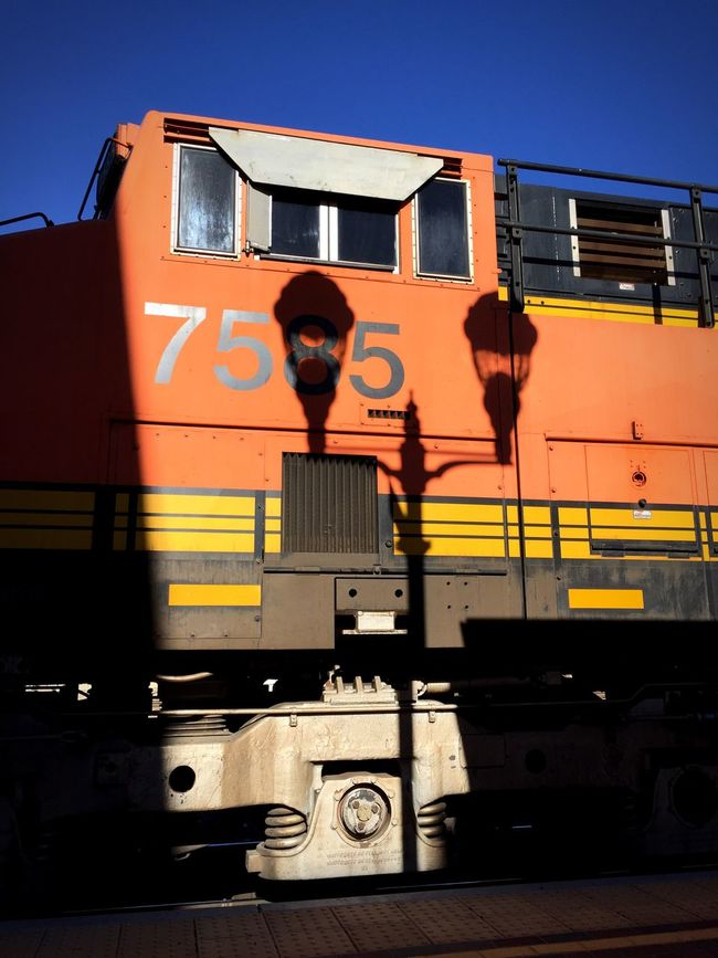 """No. 7585 And The Lamp Post"" The shadow of a double lamppost is cast on BNSF Engine No. 7585 at the Needles, California, USA trainyard. BNSF Trains Train Station Train Trainengine Railwaystation Railway Railroad Lamppost Shadows Locomotive"