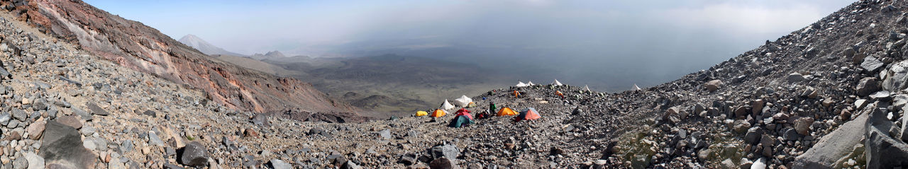 Panoramic view on the mountaineer high camp at Mount Ararat with Kucuk Agri Dagi (small Ararat) and upcoming storm in the background, Turkey Camping Desert Desolate Hiking Mountaineering Panorama Panoramic Rocky Storm Trekking Ararat  Ağrı Dağı Camp Climbing Landscape Mountain Outdoors Rocks Scenery Scenics Shelter Slope Tents Valley Volcano
