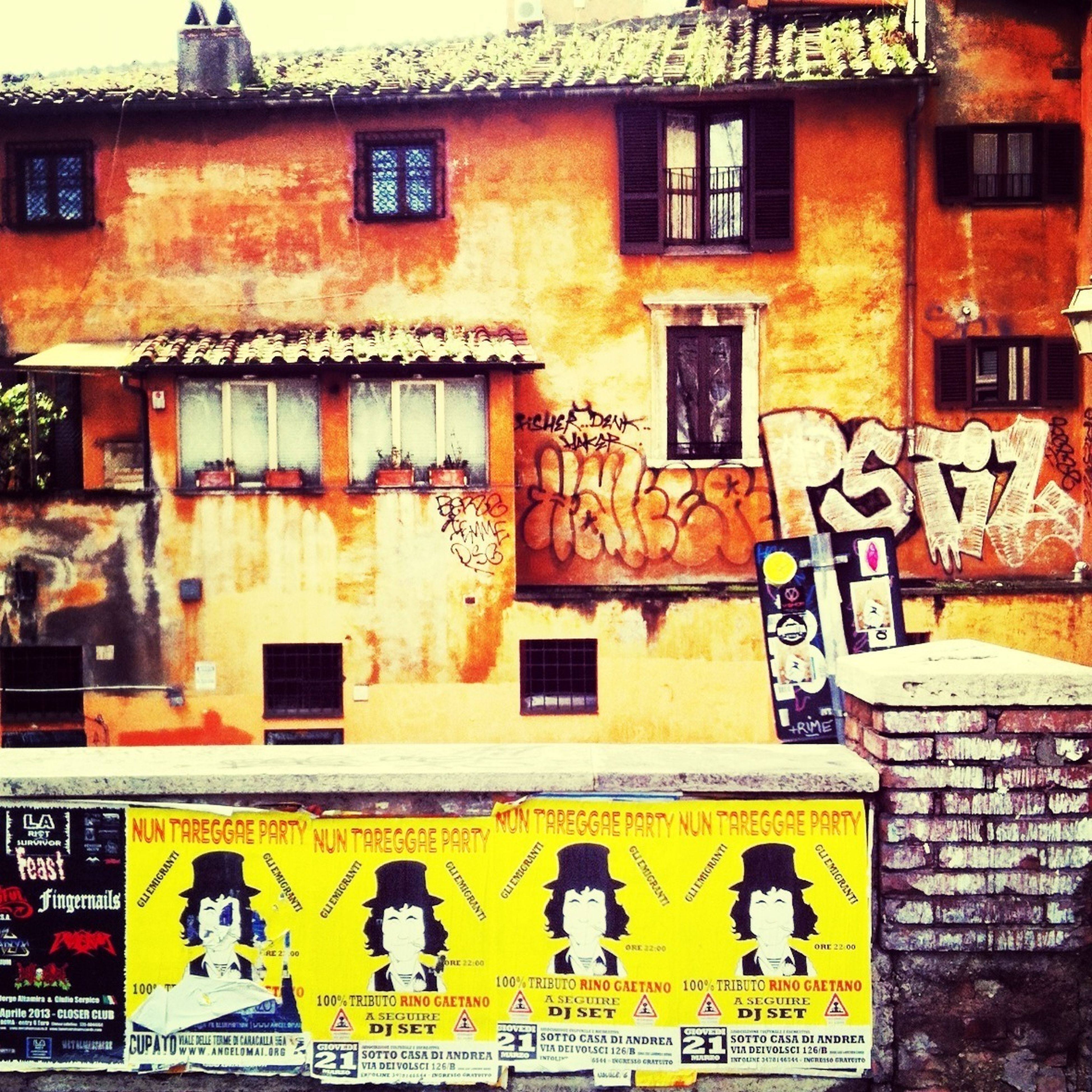 building exterior, architecture, built structure, graffiti, residential building, window, yellow, multi colored, residential structure, building, wall - building feature, day, outdoors, full frame, brick wall, art and craft, city, art, house, creativity