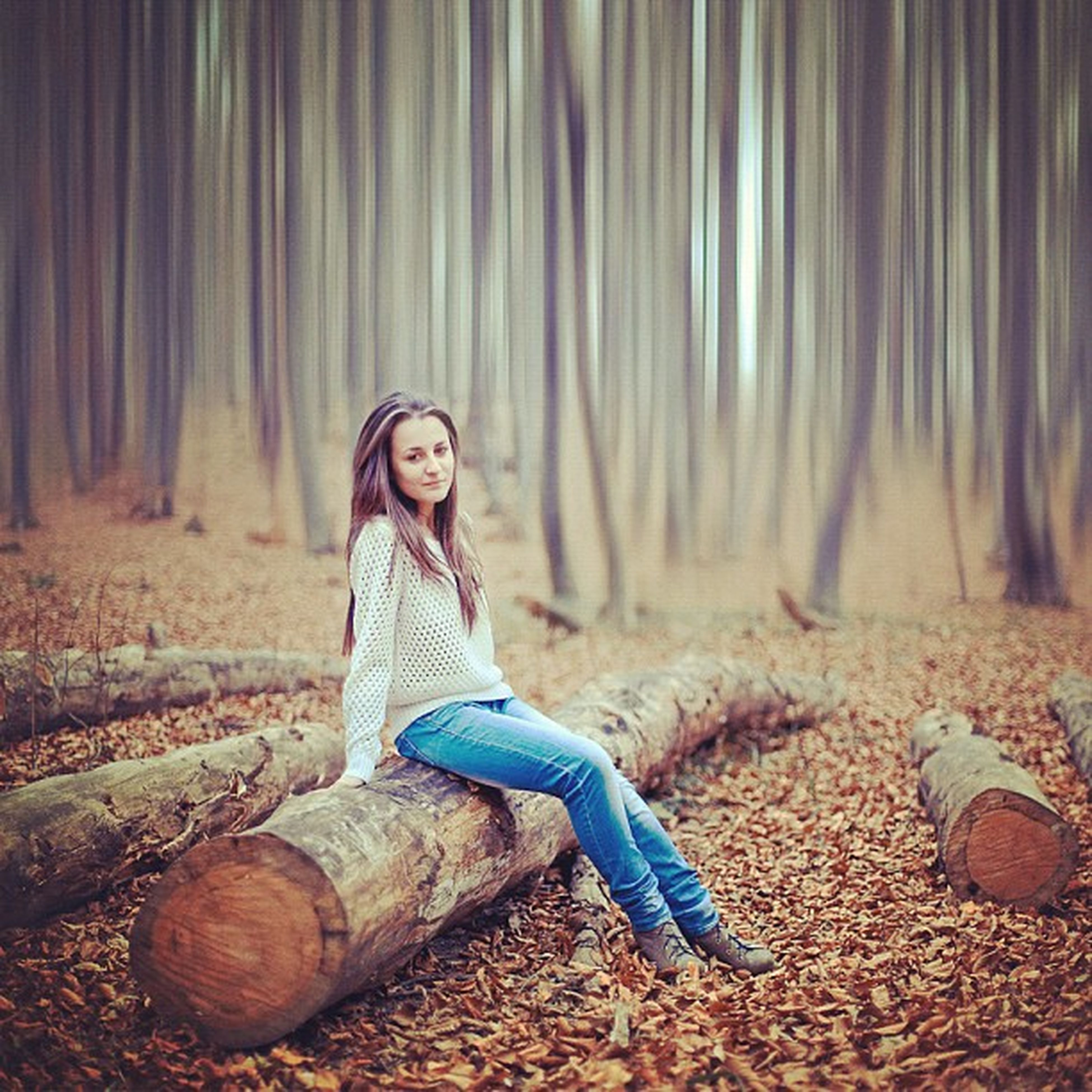 full length, tree, casual clothing, lifestyles, sitting, leisure activity, front view, forest, person, field, relaxation, shoe, day, childhood, standing, nature, outdoors, looking at camera