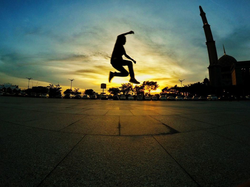You can run from the people but you can't run from your shadow. Built Structure Sunset City Silhouette Outdoors Mid-air Motion Jumping Full Length Sport Sky Real People People Masjid Putrajaya Malaysia The City Light