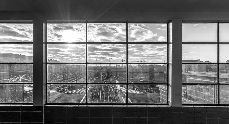 Architecture Black & White Built Structure City Cloud - Sky Day EyeEm Best Shots - Black + White EyeEm Gallery Glass - Material Indoors  Looking Through Window Nature Rails Railstation Real People Sky Subway Station Urban Exploration Window Art Is Everywhere The Secret Spaces