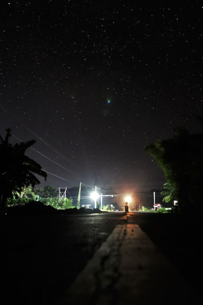 my first time taking a night sky photo Astronomy Beauty In Nature City Constellation Darkness Darkness And Light Galaxy Landscape Nature Night Night Lights Night Photography Night Sky Nightphotography No People Outdoors People Scenics Sky Space Space And Astronomy Star - Space Star Field Tree Vertical