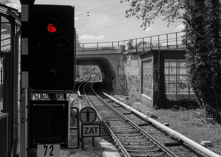 the red light ... Bahnhof Berliner Ansichten Cable City Life Keycolor Light Mode Of Transport No People Outdoors Power Line  Public Transportation Rail Transportation Railroad Track Rails Red Rot Schiene Schienen Signal Sky Station Train - Vehicle Urban Krull&Krull Images Colorkey