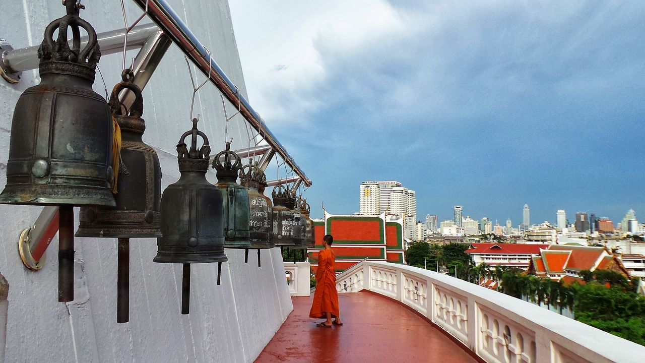 Spotted In Thailand Asian Culture Bangkok Bells Boy Buddhist Monks Buddhist Temple Building Exterior Child City Cityscapes Monk  Orange Religion Rooftops Temple Thailand White Building Ancient Built Structure Blue Sky Temple Bells Colorful Travel Photography ASIA